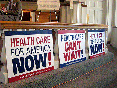 "Posters saying ""Health Care for American Now!"" and ""Health Care Can't Wait!"""