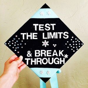 "Graduation cap that says ""test the limits and break through."